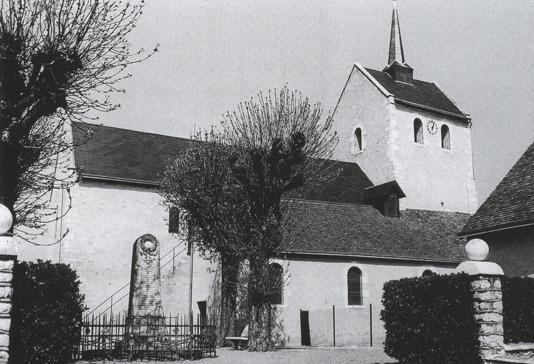 L'église St Aignan, la place de l'église et le Monument aux Morts de 1955 à 1988